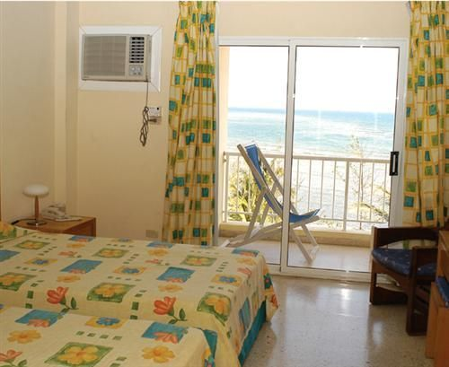 'Hotel - Costasur - room' Check our website Cuba Travel Hotels .com often for updates.