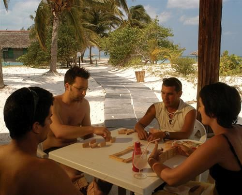 'Cayo Levisa - playing domino' Check our website Cuba Travel Hotels .com often for updates.