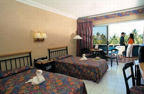 'Hotel - Brisas del caribe - habitacion' Check our website Cuba Travel Hotels .com often for updates.