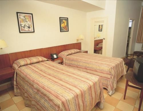 'Hotel - Colina - room' Check our website Cuba Travel Hotels .com often for updates.