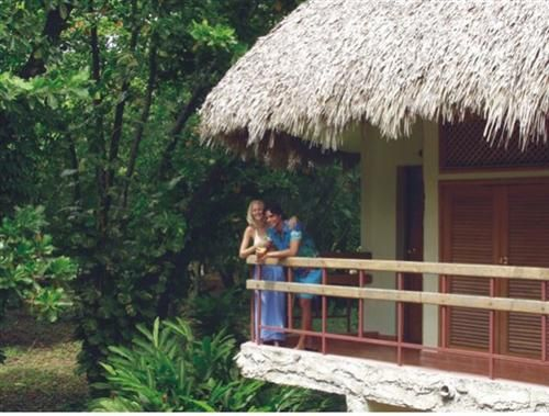 'Villa - Los Caneyes - a couple outside the cany' Check our website Cuba Travel Hotels .com often for updates.