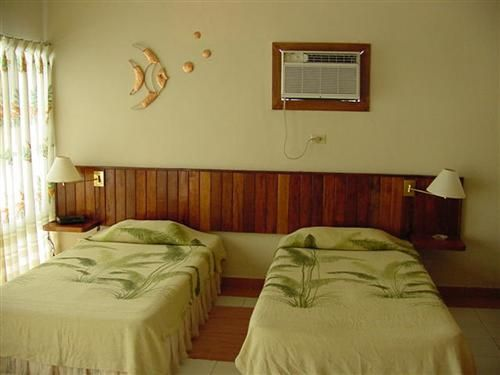 'villa - bacuranao - room' Check our website Cuba Travel Hotels .com often for updates.
